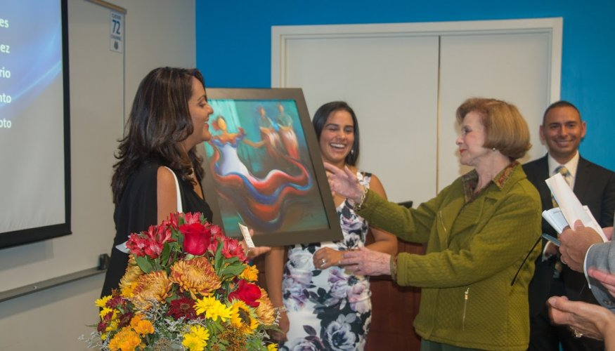 Senator Harriette Chandler receives a painting in recognition for her dedication and commitment to H.A.C.E.