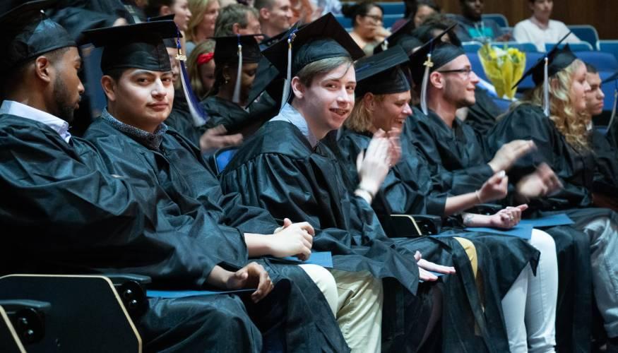 HiSet grads share a laugh.