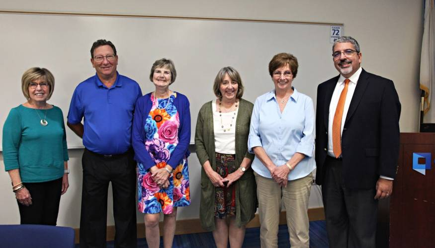 QCC President Luis Pedraja (right) stands with several retiring QCC faculty and staff.