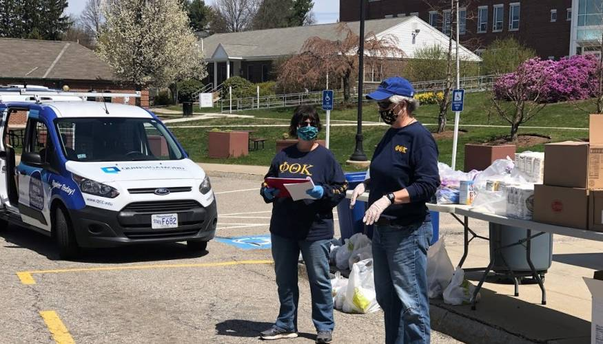 PTK Advisor Bonnie Coleman (L) and Dean of Students Terry Vecchio keep the College's food pantry running for students in need..