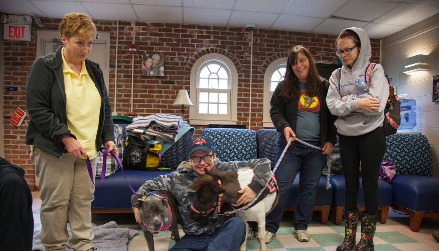 students pet animals at PAWS for People event