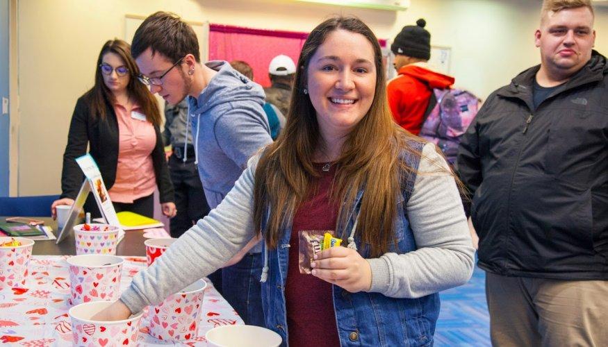 QCC Student Lindsey Renshaw enjoys some sweet treats.