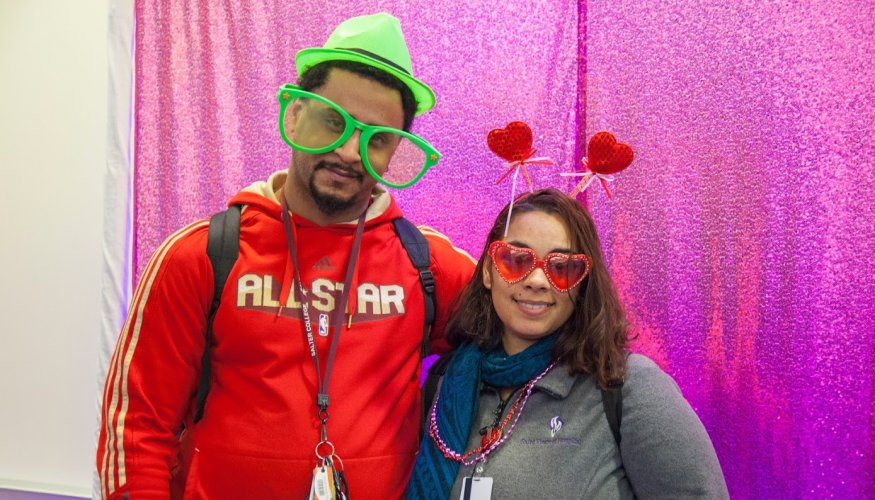 Sharing a fun moment in the photo booth are QCC students Jesus Benita and Zaidee Ortiz.