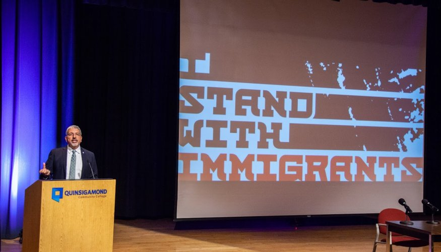 QCC President Dr. Luis Pedraja stands with Immigrants.