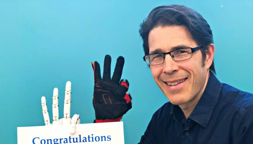 Professor Jim Heffernan gives a robotic wave to the Class of 2020.