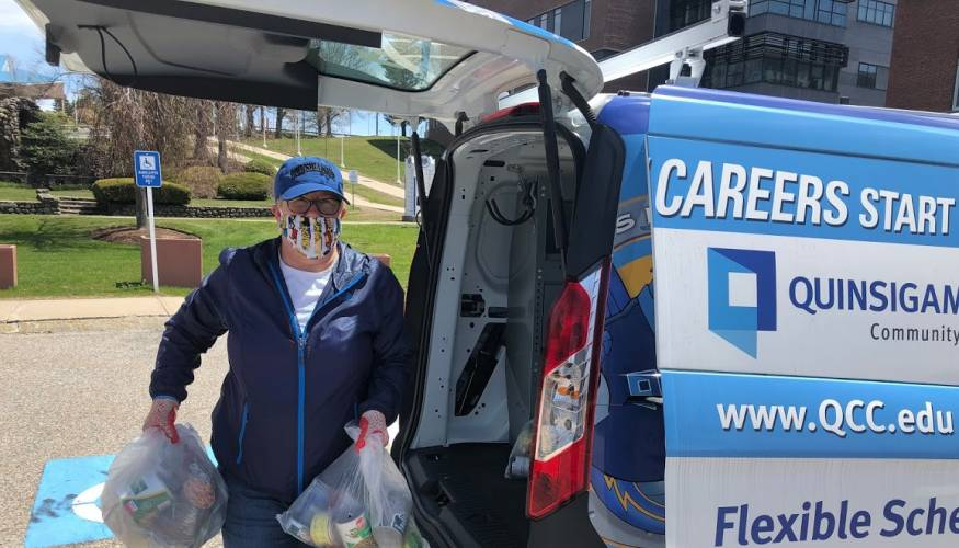 Dean of Compliance Liz Woods unloads food picked up from the Worcester County Food Bank.