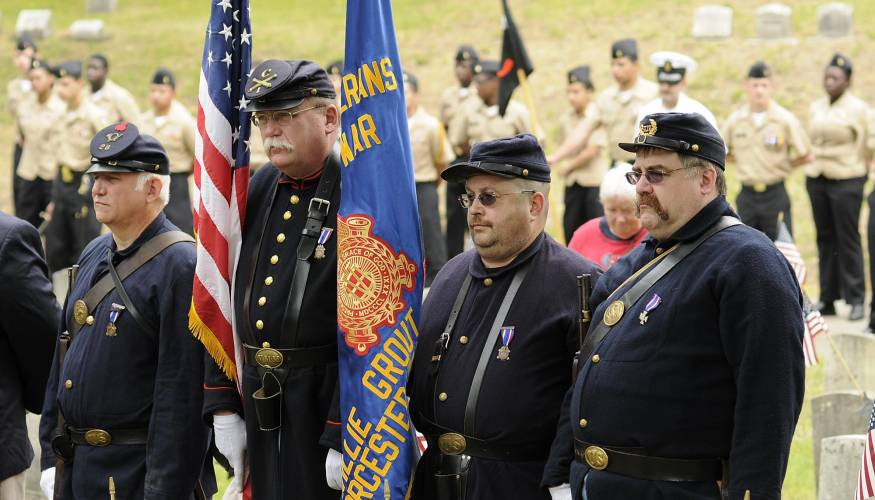 Reynaldo Rodriguez as part of the color guard on one of the Memorial Day ceremonies at Hope Cemetery.
