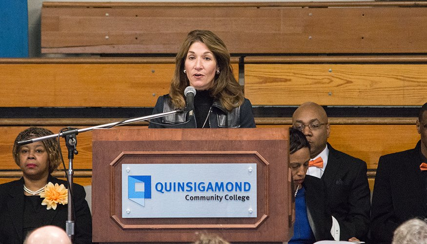 Lt. Governor Karyn Polito addresses the crowd at QCC's Athletic Center.