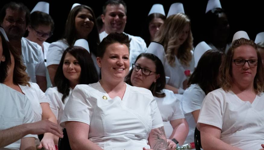 The excitement shows on the face of this newest nursing graduate.