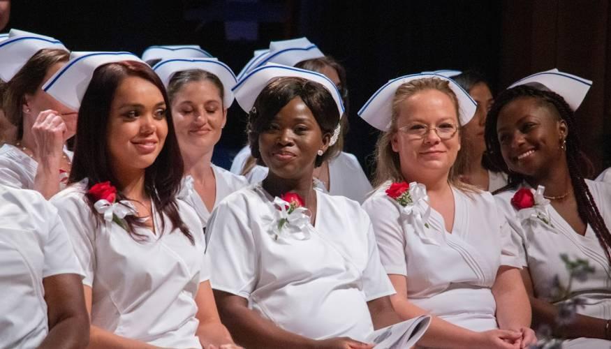 Practical Nursing graduates get ready to receive their pin.