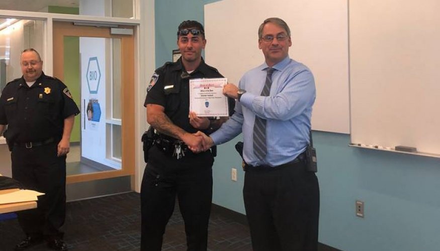 Officer Nicholas Yacuzzi received the Medal of Merit Award from QCC Police Chief Kevin Ritacco.