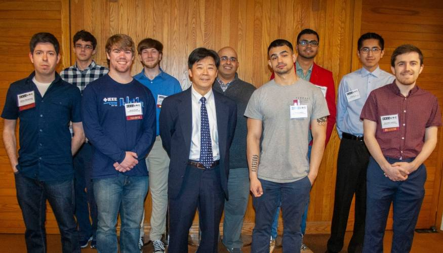 Professor Hao Loi (center) with his Computer Science students.