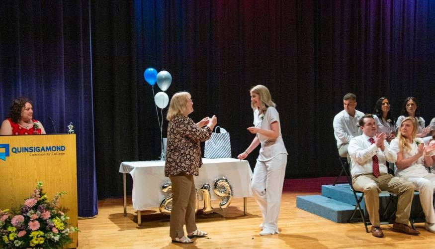 A radiologic technology graduate receives her pin.