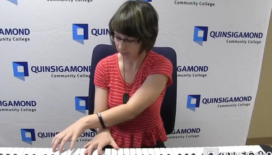 student plays keyboard