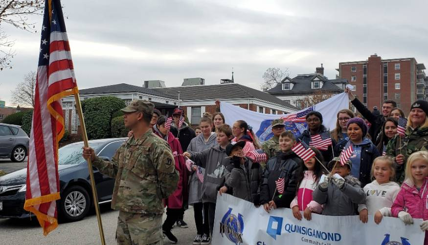 QCC student veterans and their families march in the Worcester Veterans Day Parade.