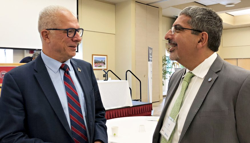 WPI Vice Provost for Research Bogdan Vernescu (L)and QCC President Dr. Luis Pedraja at the fist Integrated Photonics Symposium