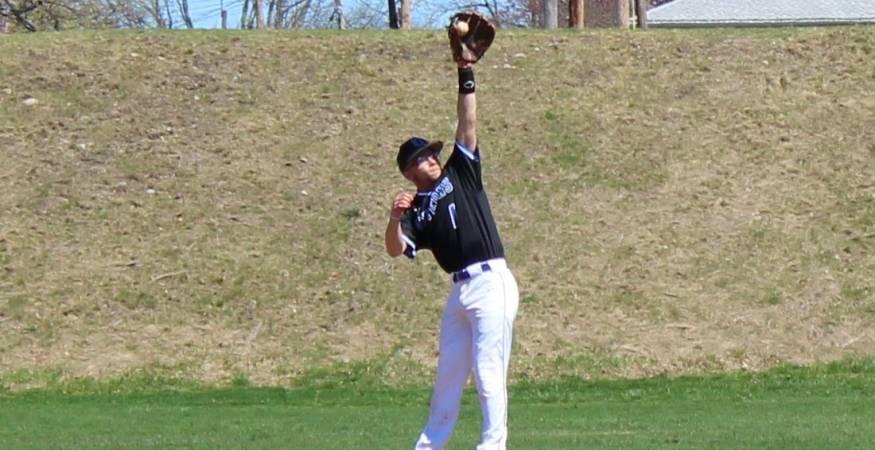 Student playing baseball