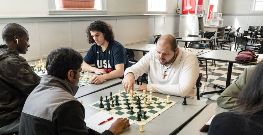 Students play chess in the cafeteria
