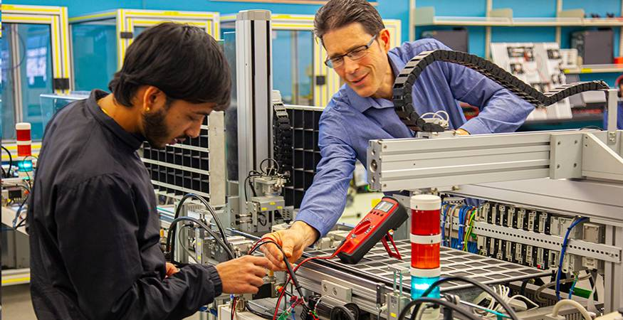 QCC student in manufacturing lab